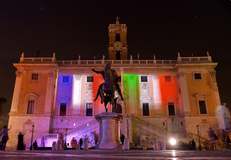 A file photo taken on January 30, 2016  shows the colours of the French and Italian flags projected on the Campidoglio in central Rome. (AFP Photo)