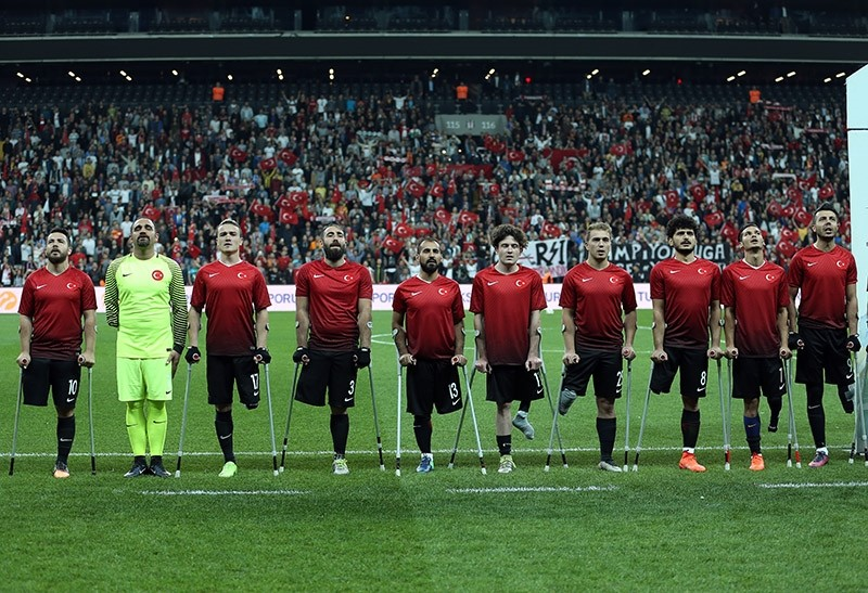 Players of Turkey stand for a moment of silence before the EAFF European Championship final against  the U.K.  at Vodafone Park in Istanbul on October 9, 2017. (AA Photo)