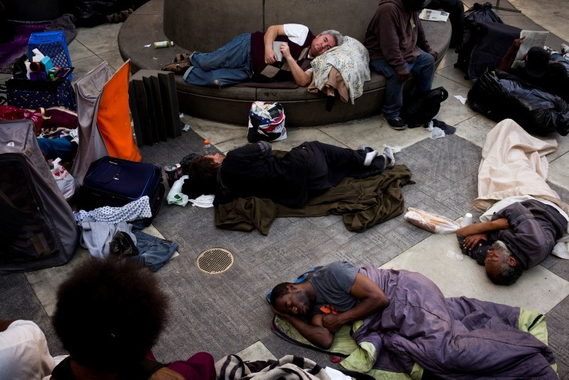 A group of homeless people sleep in the courtyard of the Midnight Mission in Los Angeles. The missionu2019s courtyard is open to all homeless people looking for a safe place to spend the night. (AP Photo)