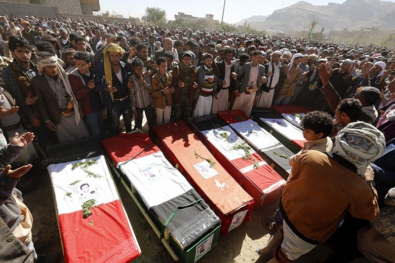 Yemenis gather around the coffins of victims of alleged Saudi-led airstrikes, during a funeral in Sana'a, Yemen, Dec. 26, 2017. (EPA Photo)