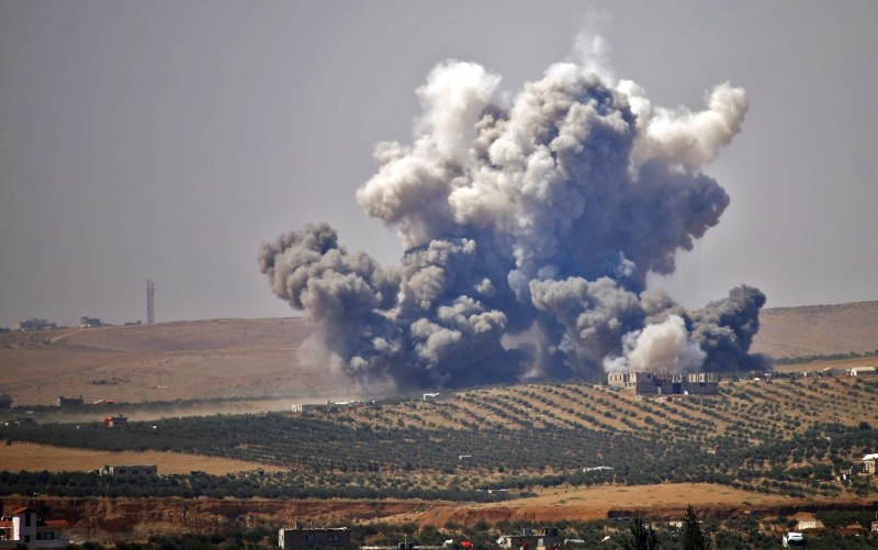 Smoke rises above rebel-held areas of the city of Daraa, during reported airstrikes by Syrian regime forces on July 5, 2018. (AFP Photo)