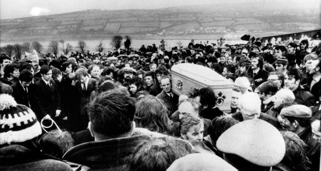 In this Feb. 2, 1972 file photo, pallbearers carry one of 13 coffins of Bloody Sunday victims to a graveside during a funeral in Londonderry, Northern Ireland. (AP Photo)