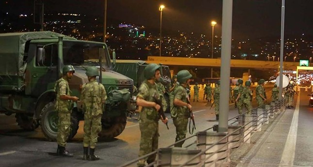 Access to the Bosphorus bridge, which links the city's European and Asian sides, in Istanbul, Turkey, blocked by soldiers during the FETÖ-led coup attempt, July 15, 2016 (Reuters Photo)