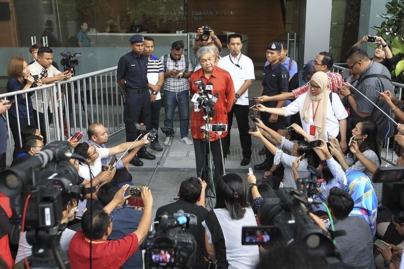 Malaysia's former Deputy Prime Minister Ahmad Zahid Hamidi, center, speaks to media outside Anti-Corruption Agency in Putrajaya, Malaysia Monday, July 2, 2018. (AP Photo)