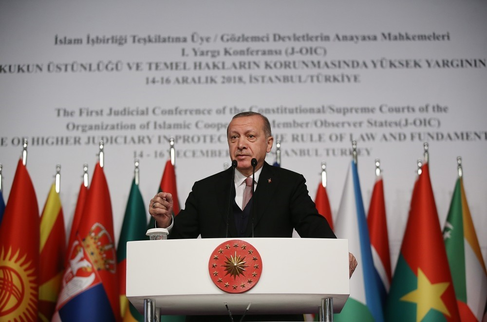 Recep Tayyip Erdou011fan addresses members of the Organisation of Islamic Cooperation (OIC) at a conference in Istanbul, Dec. 14.