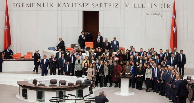 Deputies from the ruling AK Party pose for a souvenir photo marking the end of 2019 budget talks at the general assembly hall of Turkey's Parliament, in Ankara, on Dec. 22, 2018. (AA Photo)