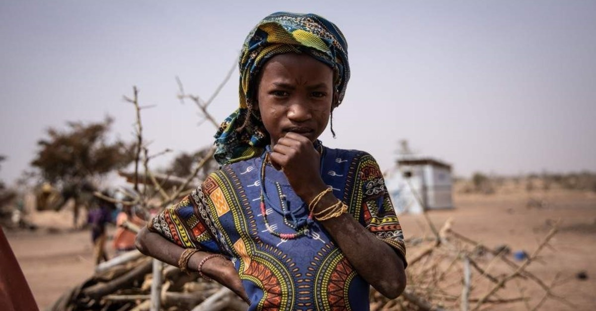 A young girl poses for a portrait at a camp for internally displaced people, Barsalogho, Jan. 27, 2020. (AFP Photo)