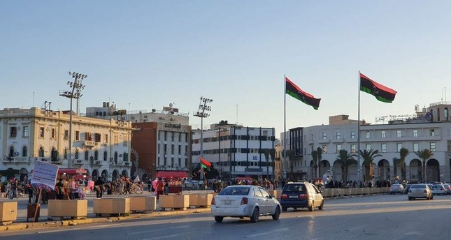 A peaceful solution to Libya's protracted conflict remains uncertain despite ongoing diplomatic efforts, as local people in the capital Tripoli expect the war to end and stability to be established, Jan. 20, 2020. AFP Photo