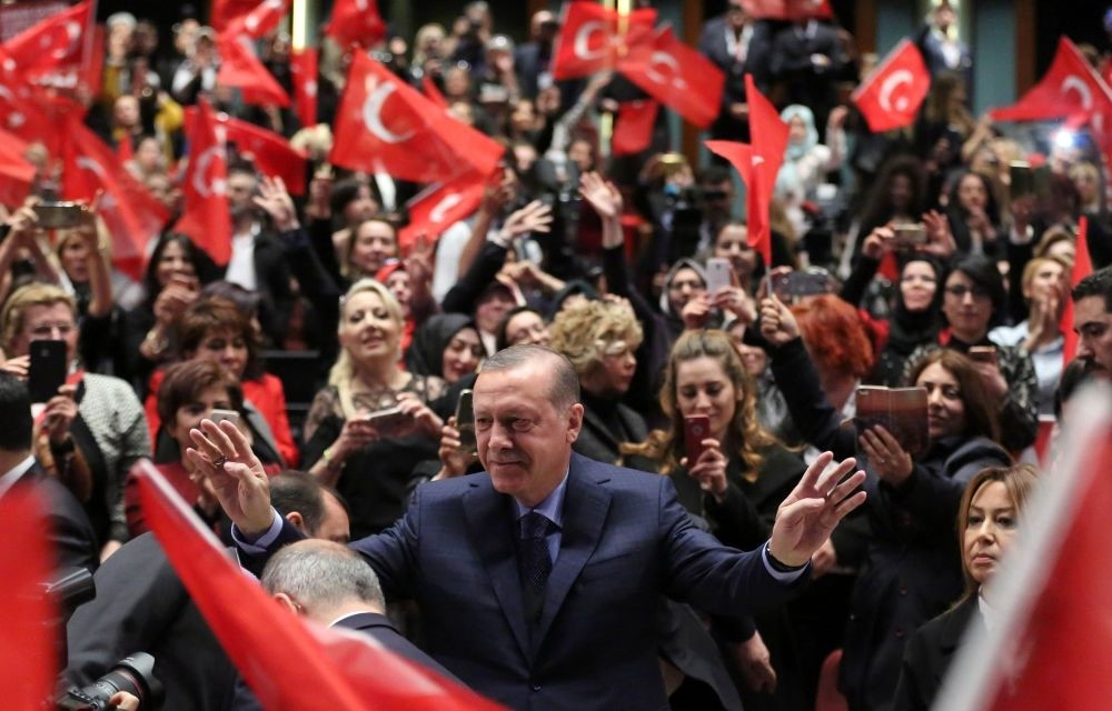 President Erdou011fan (C) greeting supporters as he attends a ,yes, campaign meeting at the Presidential Complex's People's Culture and Congress Center in Ankara, March 29.  (AFP Photo)