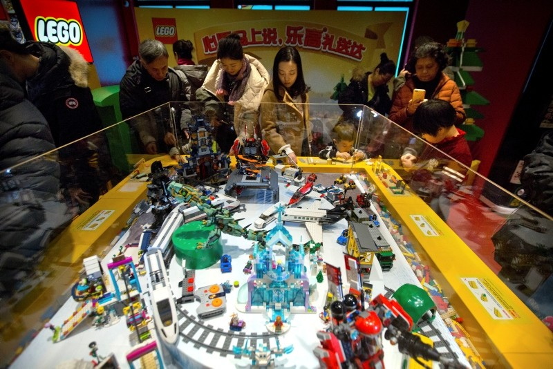 People look at a display of Lego creations at Hamley's toy store duru0131ng its grand opening in Beijing, Saturday, Dec. 23, 2017. (AP Photo)