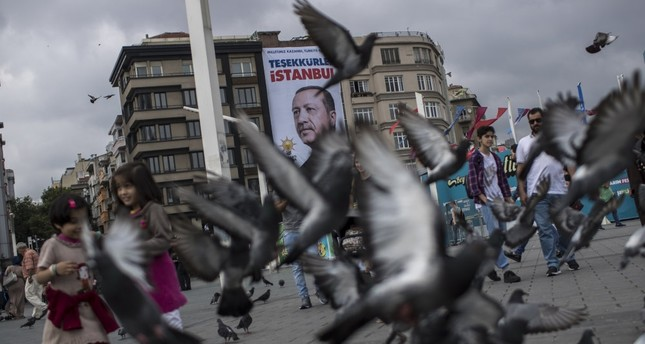 Pedestrians walk in front of a poster of President Recep Tayyip Erdoğan, which reads Thank You, Istanbul, two days after the June 24 presidential vote in 2018, in Taksim Square, Istanbul.