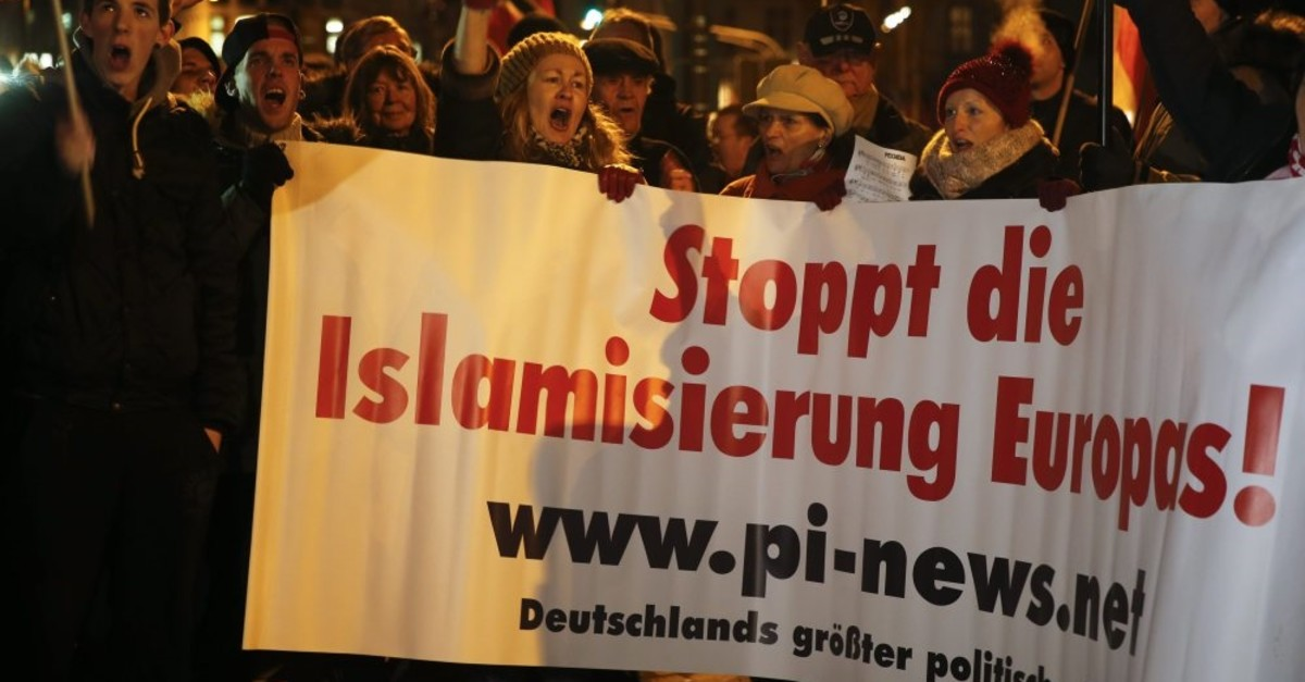 People take part in a march of a grassroots anti-Muslim movement, Cologne, Jan. 5, 2015.