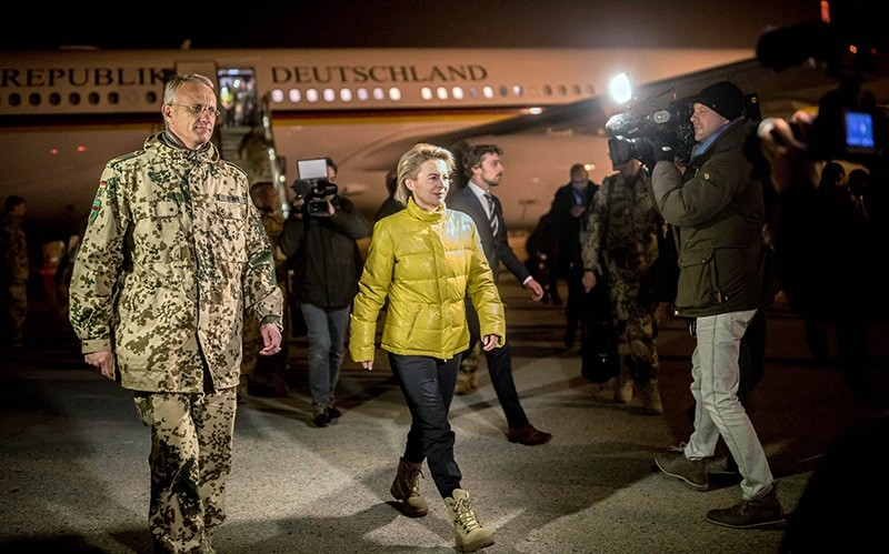 German Defence Minister Ursula von der Leyen (R)and Federal Armed Forces commander Wolf-Juergen Stahl walk over the tarmac after von der Leyen's arrival at Camp Marmal in Mazar-i-Sharif, northern Afghanistan, on December 18, 2017. (AFP Photo)