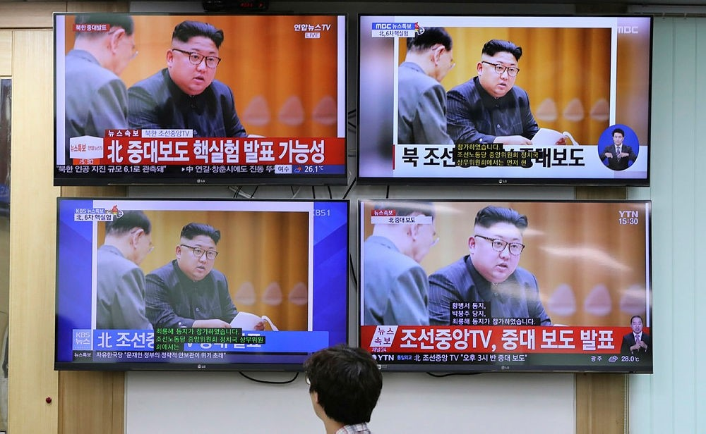 An officer from National Meteorological Center watches news programs showing pictures of North Korean leader Kim Jong Un in Seoul, South Korea, Sunday, Sept. 3, 2017. (AP Photo)