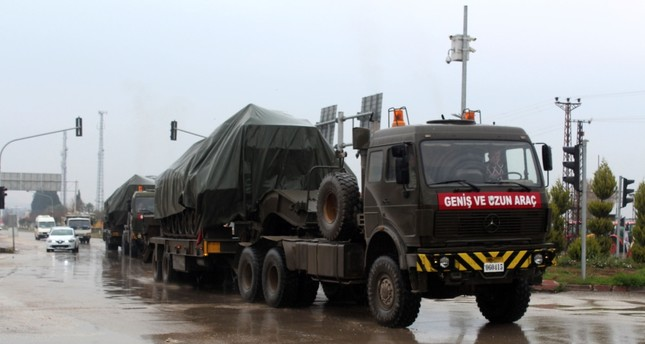 Trucks carry tanks in Turkey's southern city of Hatay as Ankara prepares to launch a counterterrorism offensive against PKK-affiliated elements in Afrin, Syria, near its border, Jan. 16.