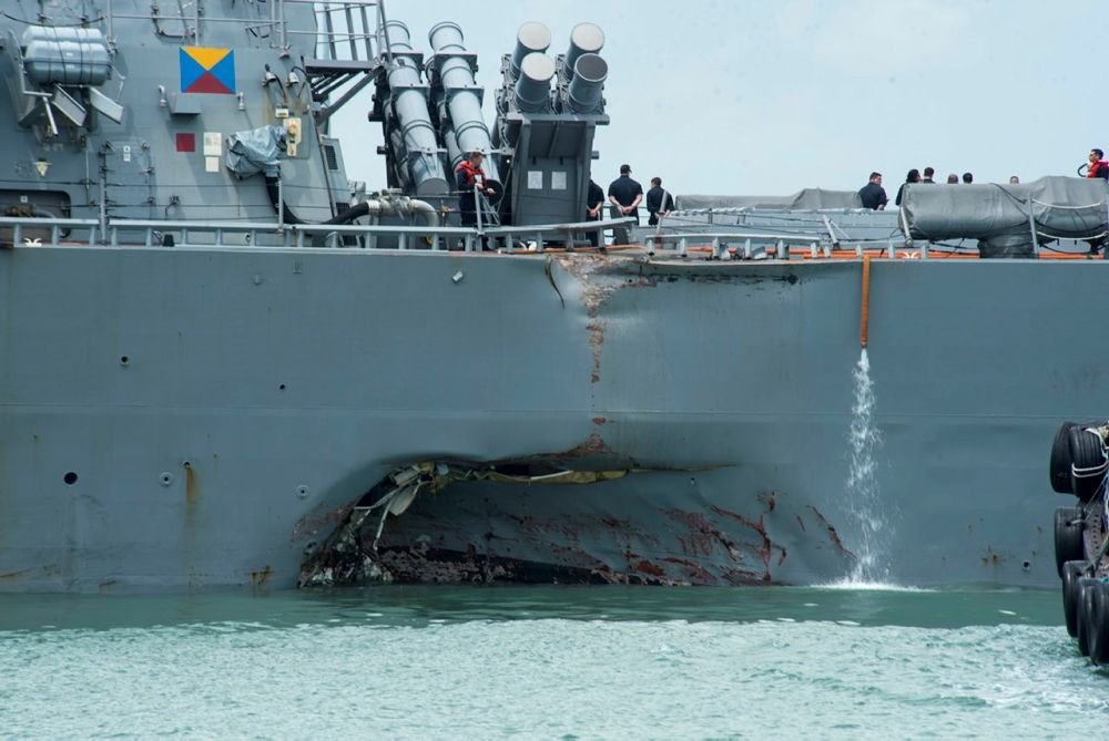 The United States Navy 7th Fleet shows the damaged hull on the port side of the United States Navy missile destroyer USS John S. McCain while berthed at the Changi Navy Base in Singapore, 21 August 2017. (EPA Photo)