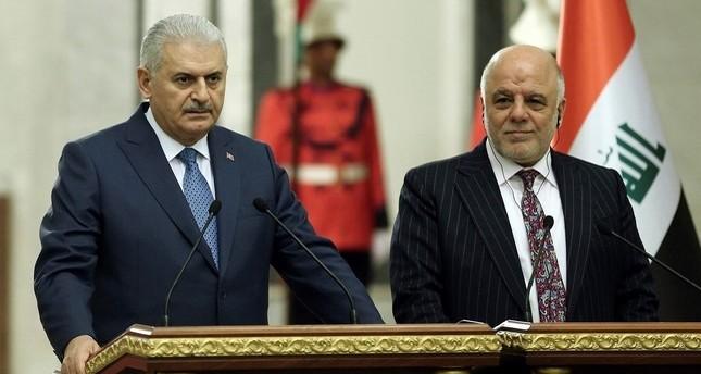 PM Yıldırım (L) and Iraqi counterpart Abadi