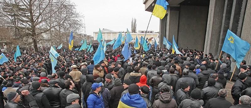 Crimean Tatar activists attend a protest near the Parliament building in Simferopol, Crimea. (File Photo)