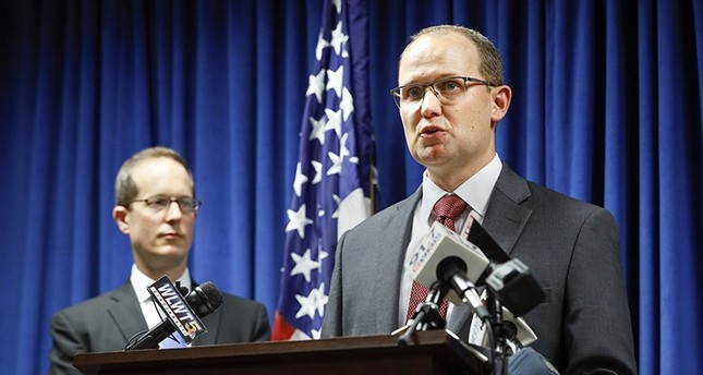 Herb Stapleton, Assistant Special Agent in Charge, FBI, right, speaks alongside U.S. Attorney Benjamin C. Glassman, left, during a news conference, Wednesday, Oct. 10, 2018, in Cincinnati. AP Photo
