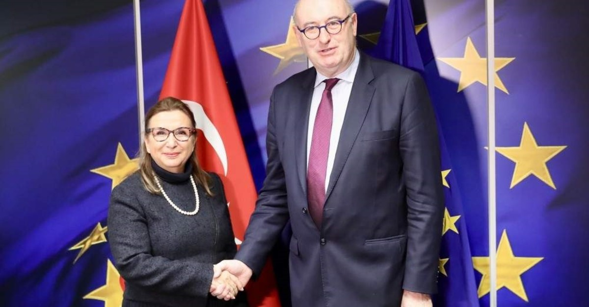 Trade Minister Ruhsar Pekcan (L) shakes hand with European Commissioner for Trade Phil Hogan, Brussels, Belgium, Dec. 20, 2019. (AA Photo)