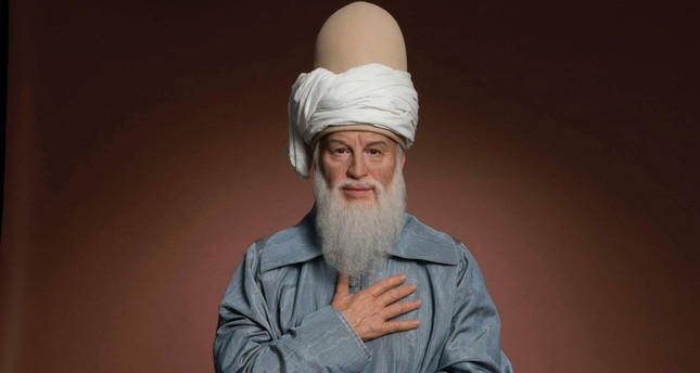 Wax sculpture of Rumi at Madame Tussauds.
