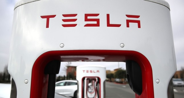 In this file photo taken on January 30, 2019, Tesla cars recharge at a Tesla Supercharger facility on in Petaluma, California. (AFP Photo)