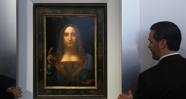 Security guards open a door to reveal Salvator Mundi by Leonardo da Vinci during a news conference at Christie's in New York, Tuesday, Oct. 10, 2017. (AP Photo)