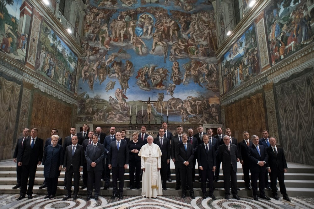 Pope Francis poses for a family picture in the Sistine Chapel after an audience with European Union leaders in Vatican, on March 24.