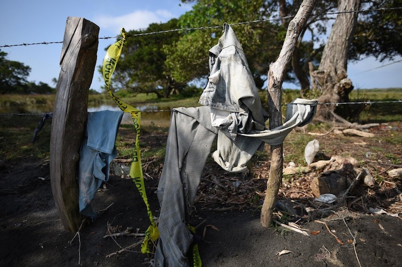 Clothing is pictured on a wire fence at site of unmarked graves where a forensic team and judicial authorities are working in after human skulls were found, in Alvarado, in Veracruz state, Mexico. (Reuters Photo)
