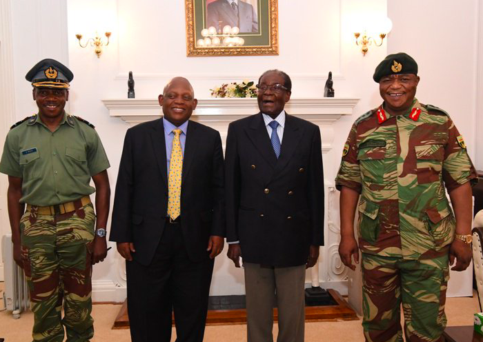 Zimbabwe President Robert Mugabe (2nd right) stands with the army commander (1st right) who staged a coup in the country last week. (Source: state-run Zimbabwe Herald newspaper)