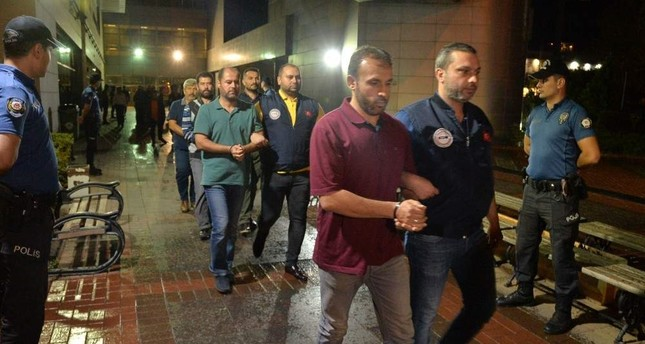 Police accompany 14 FETÖ suspects to prison, Mersin, Oct. 29, 2019. The terrorist group faces operations almost on a daily basis since the 2016 coup attempt. (DHA Photo)