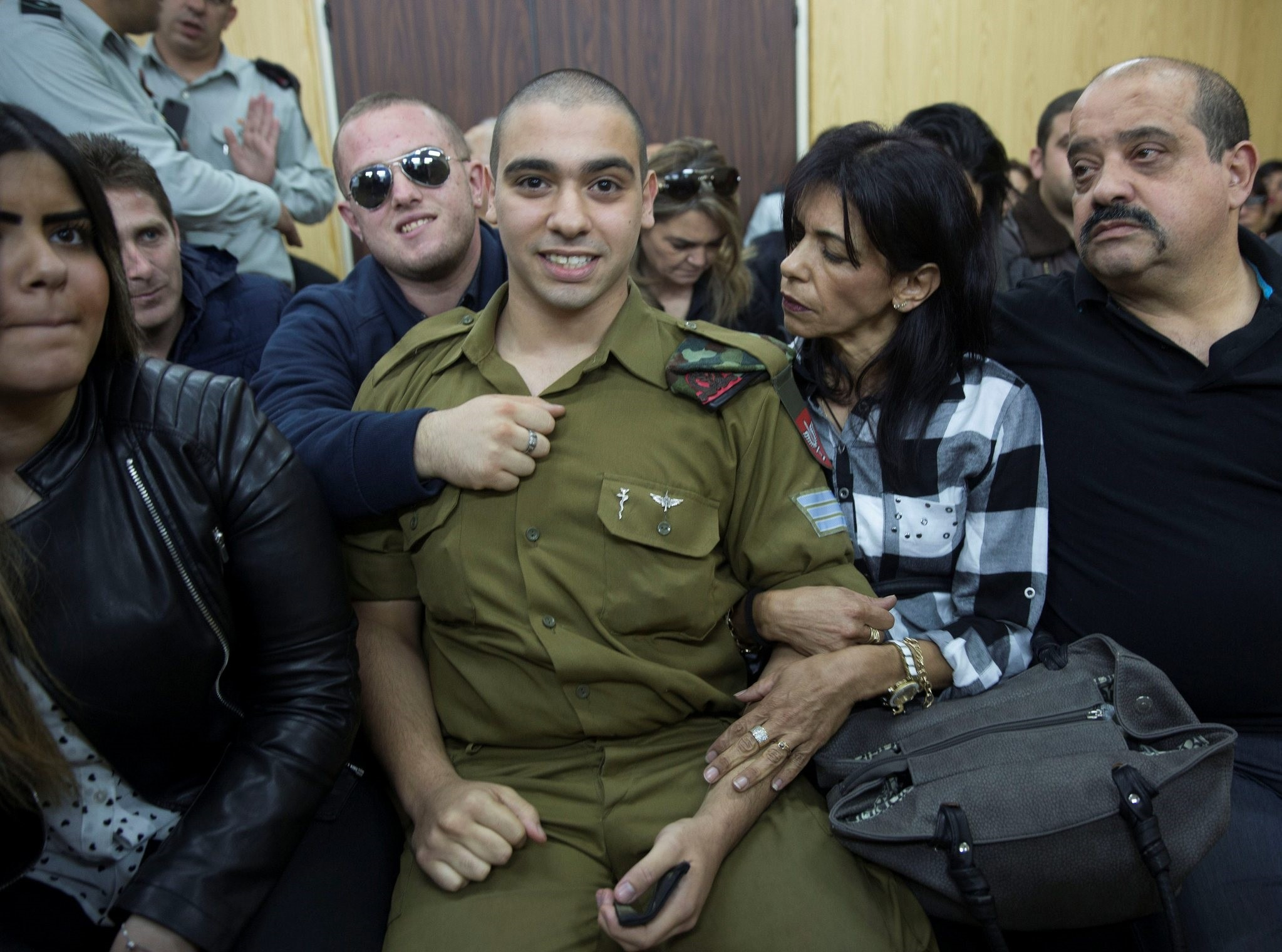 Israeli soldier Elor Azaria, who is charged with manslaughter by the Israeli military, sits to hear his verdict in a military court in Tel Aviv, Israel, January 4, 2017. (REUTERS Photo)