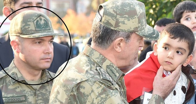 In this file photo, Lt. Cl. Levent Türkkan is pictured beside Turkey's Chief of Staff Hulusi Akar