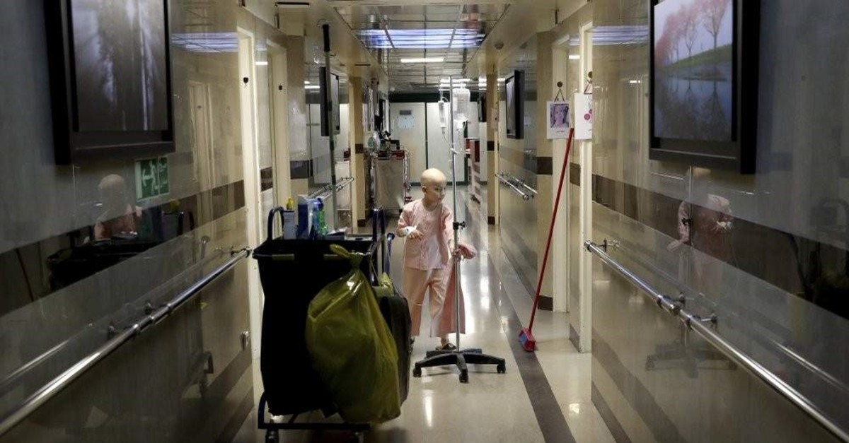An 8-year-old boy with from liver cancer plays in the corridors of the Mahak charity children's hospital, Tehran, June 19, 2019. (AP Photo)