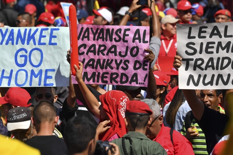 Workers from Venezuela's state oil company, PDVSA, participate in an ,anti-imperialist, march promoted by the government to support President Nicolas Maduro, in front of the Miraflores Presidential Palace in Caracas, on January 31, 2019. (AFP Photo)