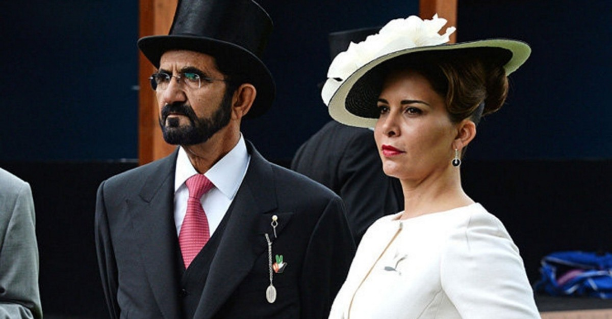 Sheikh Mohammed bin Rashid Al Maktoum (L) and Princess Haya bint Al Hussein attend Derby Day during the Investec Derby Festival, celebrating The Queen's 90th Birthday, at Epsom Downs Racecourse on June 4, 2016 in London. (GETTY IMAGES)