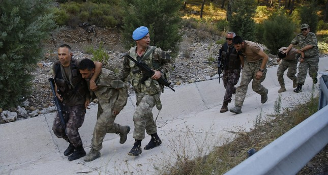 Security forces accompany pro-coup troops captured days after they went into hiding in a forest, after their plot to kill Erdoğan was foiled.