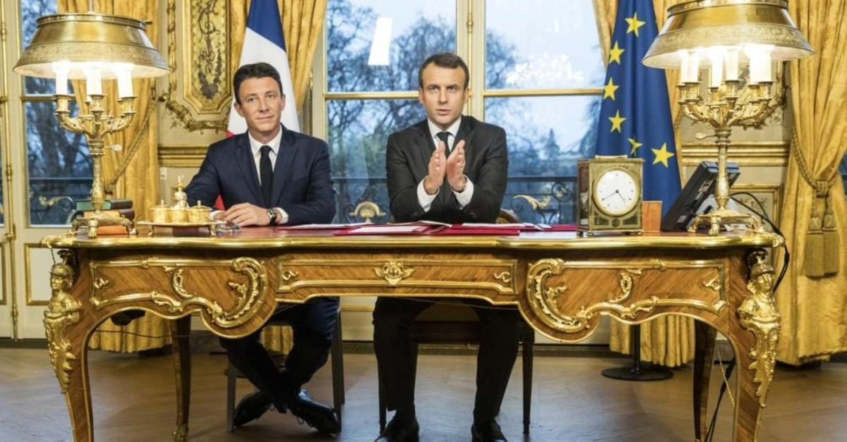 French President Emmanuel Macron delivers a speech next to his former government spokesperson, Benjamin Griveaux, at Elysee Palace, Paris, Dec. 30, 2017. (AP Photo)