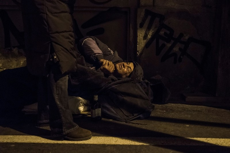 This undated file photo shows an activist of Asylum Foundation standing next to a homeless person on a street as he and his colleagues patrol the streets to assists homeless people in the winter of 2017 in Budapest, Hungary. (EPA Photo)