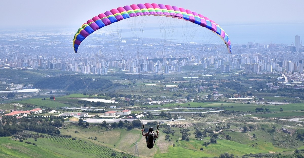 Paragliders enjoy the good weather over the Gelincik Hill on the foothills of the Taurus Mountains in Mersin.