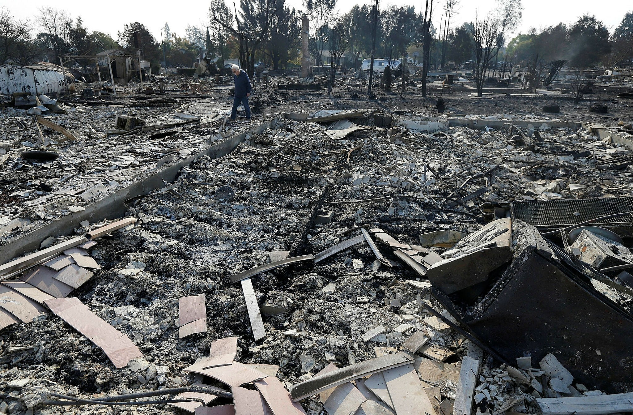 Phil Rush walks through the burnt remains at the site of his home destroyed by fires in Santa Rosa, Calif., Wednesday, Oct. 11, 2017. (AP Photo)