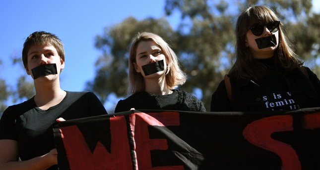 Students of the Australian National University participate in a protest after the release of the national student survey on sexual harassment in Canberra, August 1, 2017. (EPA Photo)