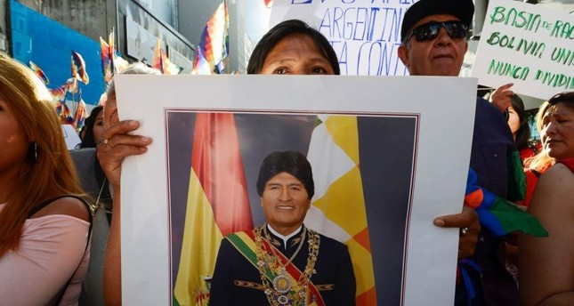 A supporter of Bolivia's President Evo Morales holds a portrait of Morales during a march, in Buenos Aires, Argentina Nov. 8, 2019.  (REUTERS)