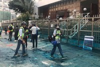Hong Kong police fire water cannon with blue dye at mosque