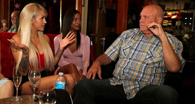 Dennis Hof, owner of the Moonlite BunnyRanch legal brothel and recent winner of the Republican primaries for Nevada State Assembly District 36, sits in the parlor of the brothel with legal prostitutes, in Nevada, U.S. June 16, 2018. (Reuters Photo)