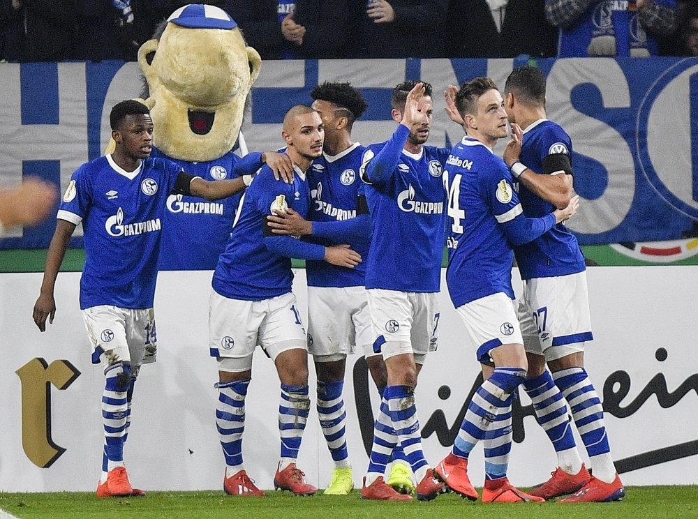 Kutucu (second left) celebrate after scoring the opening goal against Fortuna Duesseldorf in Gelsenkirchen, Germany, Feb. 6, 2019.