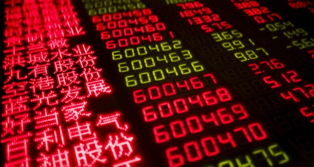 Stock price movements are seen on a screen at a securities company in Beijing on February 7, 2018. (AFP Photo)