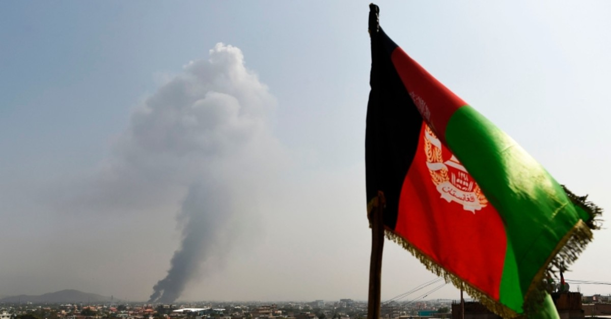 Smoke rises as angry people residents set fire to part of the Green Village compound that has been attacked frequently, a day after a Taliban suicide attack, Kabul, Afghanistan, Sept. 3, 2019. (AFP Photo)