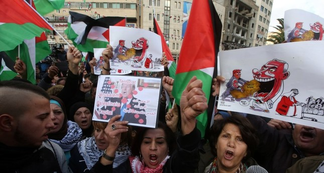 Palestinian protestors shout slogans against the U.S. during a protest  in Nablus, West Bank, Dec. 7.