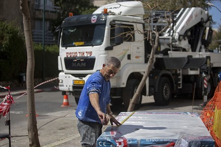 Palestinian construction worker Fuad Maraita works in the central Israeli city of Ramat Hasharon. (AP Photo